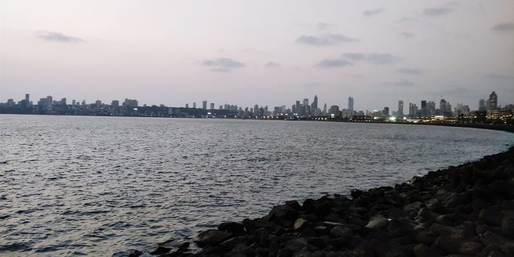The Queen's necklace! Marine Drive!! Beach Beachphotography Seaview Sea Seascape Sea And Sky City Cityscape Urban Skyline Cold Temperature Sunset Water Sky Coast Tide Coastline Rocky Coastline Shore Horizon Over Water