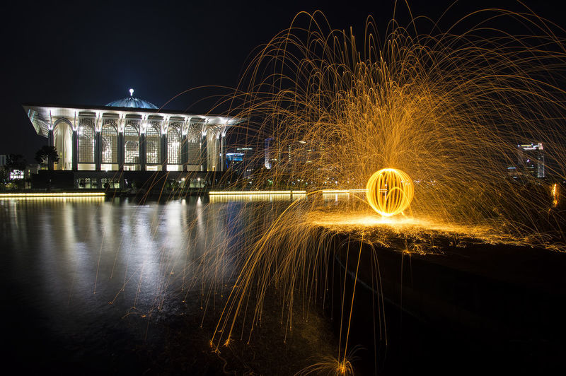 Light painting with Tuanku Mizan Zainal Abidin Mosque background Architecture Fire Light Painting Long Exposure Mosque Night Photography Putrajaya,malaysia Steel Mosque Water
