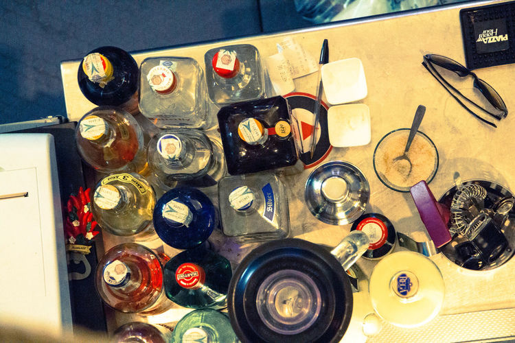 High angle view of various bottles on table