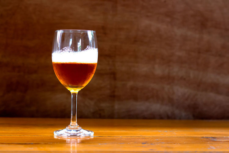 Alcohol Alcoholic Drink Beer Glass Close-up Day Drink Drinking Glass Focus On Foreground Food And Drink Freshness Frothy Drink Indoors  No People Refreshment Table Wine Wineglass Wood - Material