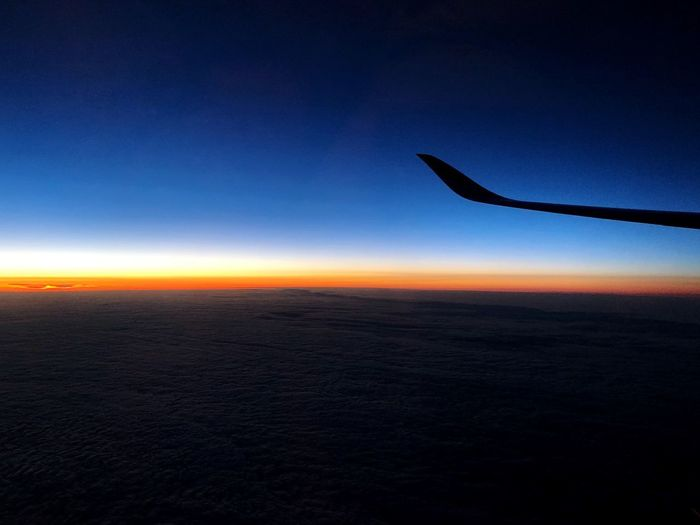 Goodbye old day? Hello new day? Is this Jetlag? What time is it right now? Holiday POV Airplane Wing Flight View Copy Space Sky Sunset Silhouette Beauty In Nature Scenics - Nature Tranquility Nature