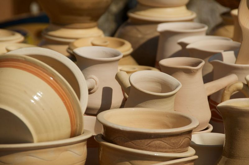 Close-Up Of Ceramic Jugs And Bowls