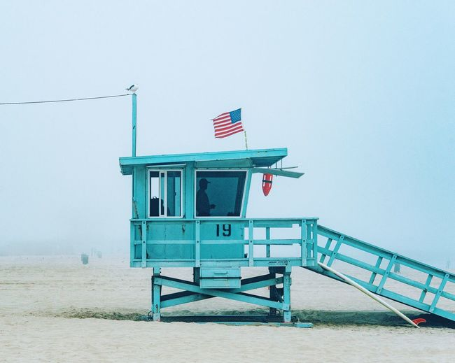 Foggy Morning Flag Patriotism Built Structure Security Architecture Sky Lifeguard Hut Beach