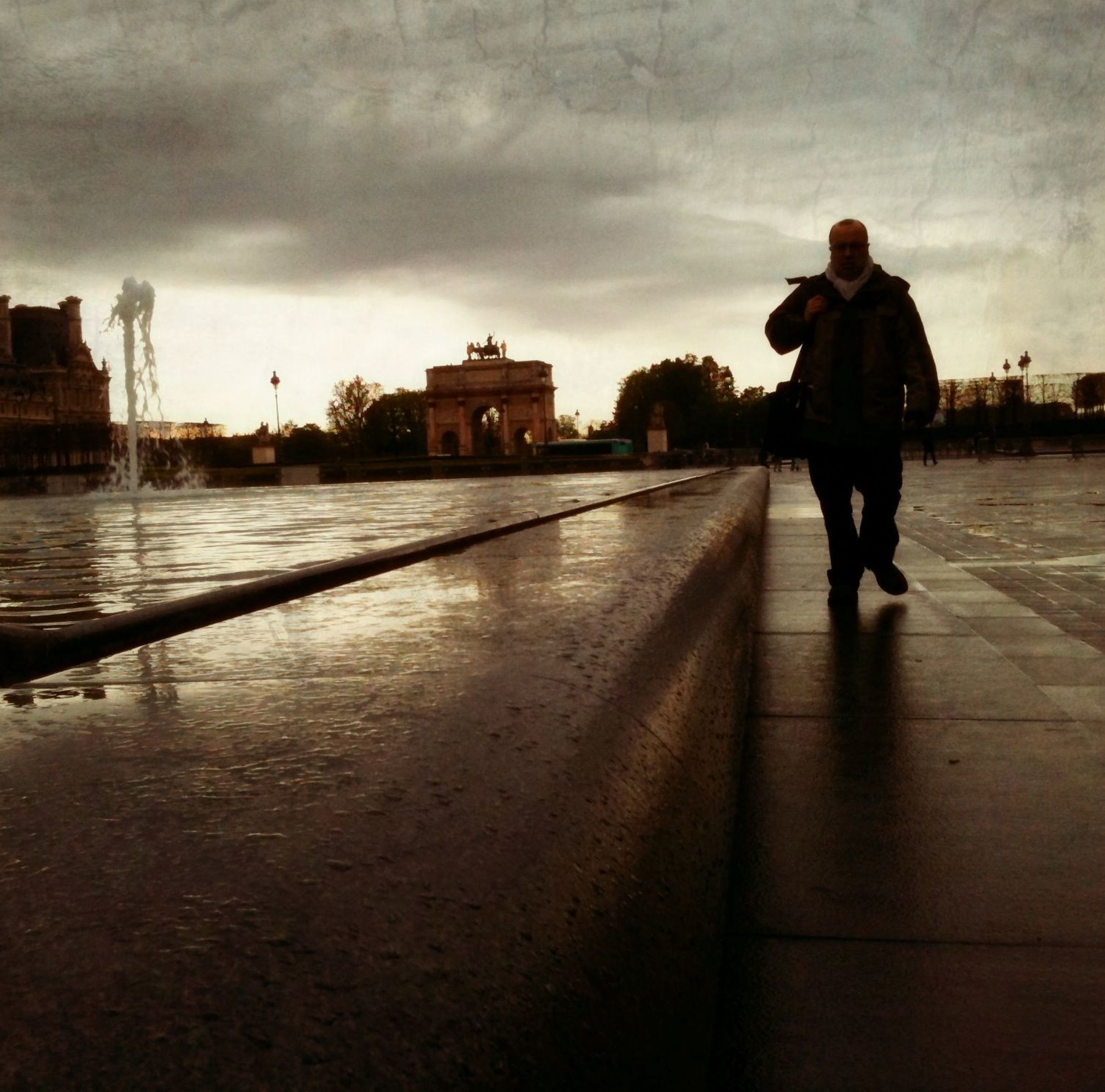 sky, full length, building exterior, built structure, architecture, water, cloud - sky, lifestyles, rear view, leisure activity, standing, walking, cloudy, cloud, casual clothing, men, dusk, the way forward
