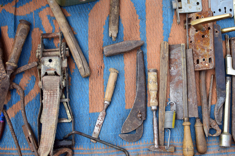 High angle view of hand tools on mat