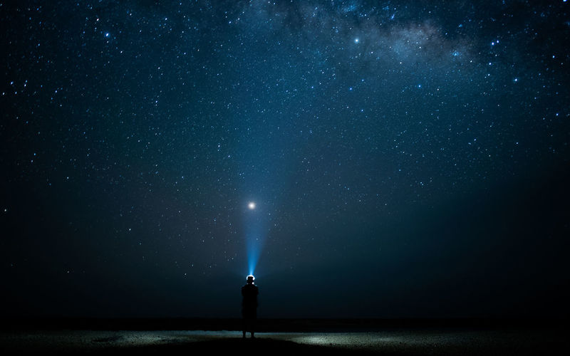 Jupiter Light Beam Astronomy Beauty In Nature Constellation Exploration Flashlight Fun With Lights Galaxy Illuminated Infinity Milky Way Nature Night One Person Scenics - Nature Sky Space Space And Astronomy Standing Star Star - Space Star Field