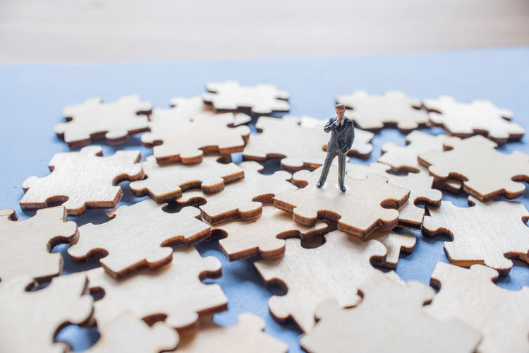 Figurine On Wooden Jigsaw Puzzle