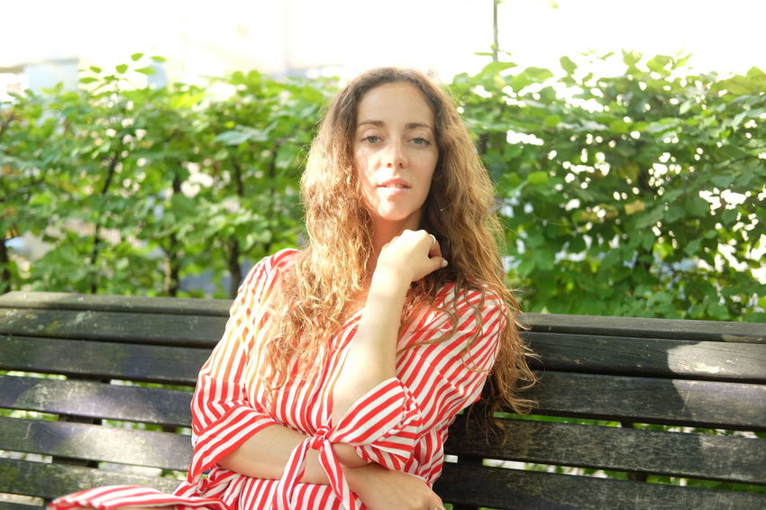 Summer in the park Beautiful Woman Beauty Bench Brown Hair Contemplation Day Hair Hairstyle Leisure Activity Lifestyles Long Hair Looking At Camera One Person Outdoors Park Bench Portrait Seat Sitting Smiling Teenager Women Young Adult