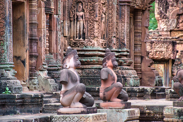 Banteay srei or banteay srey temple site among the ancient ruins of angkor wat hindu temple complex
