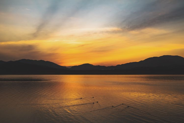 Sunset Mountain Beauty In Nature Scenics Nature Tranquility Sky No People Lake Outdoors Day Water Mountain Range