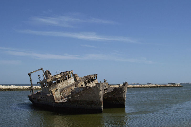 Ship graveyard near Nouadhibou, Mauritania Sahara Desert Ship Graveyard West Africa Abandoned Africa Barren Barren Landscape Damaged Day Graveyard Mauritania No People Nouadhibou Outdoors Sahara Ship Sky