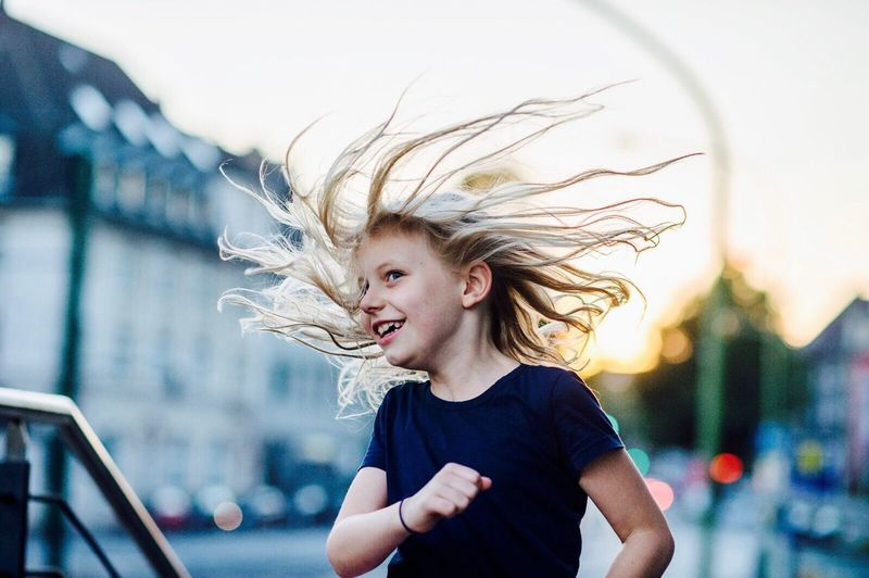 Girl running and smiling