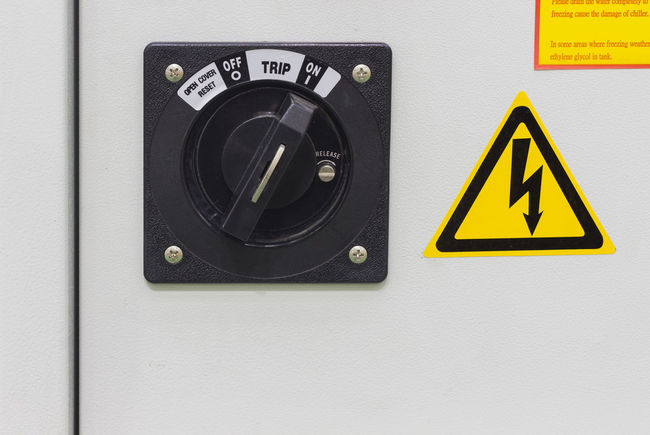 Black Color Close-up Communication Control Electricity  Electricity  Equipment High Voltage Sign Industry Information Information Sign No People Pannel Push Button Shape Sign Technology Text Wall - Building Feature Warning Sign Warning Symbol White Color Yellow