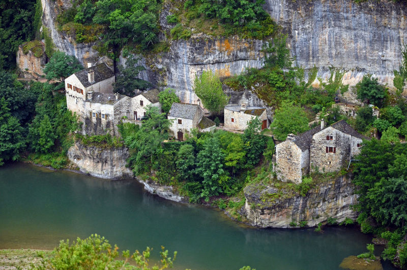 High angle view of houses on cliff by sea