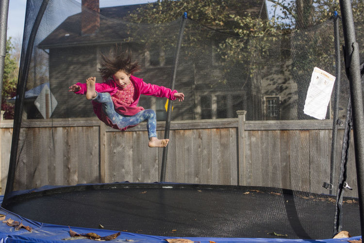 Low angle view of girl playing in playground