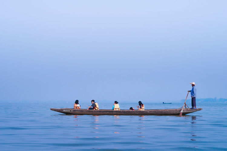 Traveling boat in the lake. Travel Boat Fresh Group Group Of People Lake Nature Outdoors People Sailing Sky Water