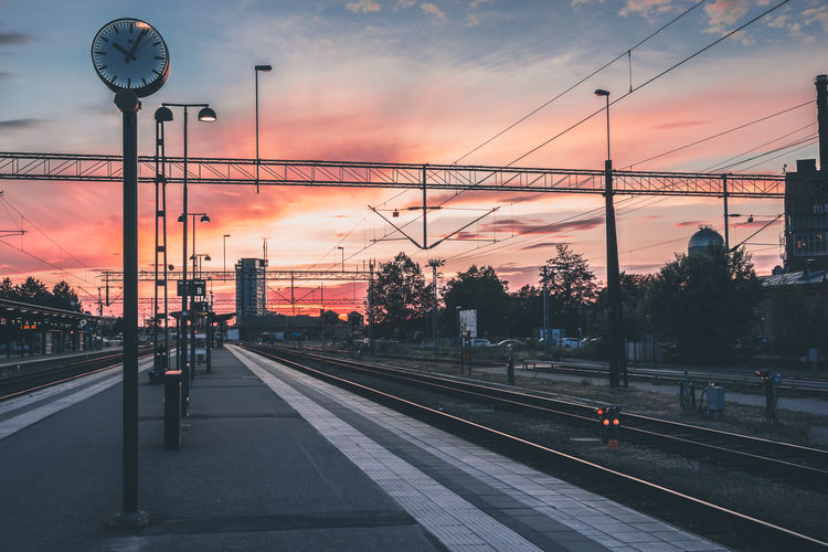 Train station at sunset. Clouds sky and sunlight at its best. Cloud - Sky Dramatic Sky Journey Outdoors Power Line  Public Transportation Rail Transportation Railroad Station Railroad Track Sky Sunset Sunset_collection Travel Destinations Travel Photography
