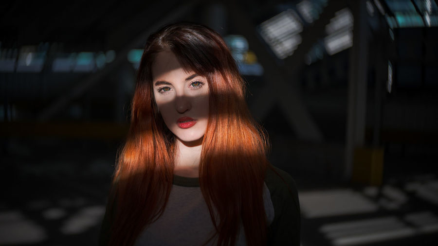 gaps of sunlight. TCPM One Woman Only Adult People Long Hair Portrait Red Lipstick The Secret Spaces EyeEm Masterclass Beauty Light And Shadow Today's Hot Look Fashion Model Resist Spirituality Art Is Everywhere Paint The Town Yellow