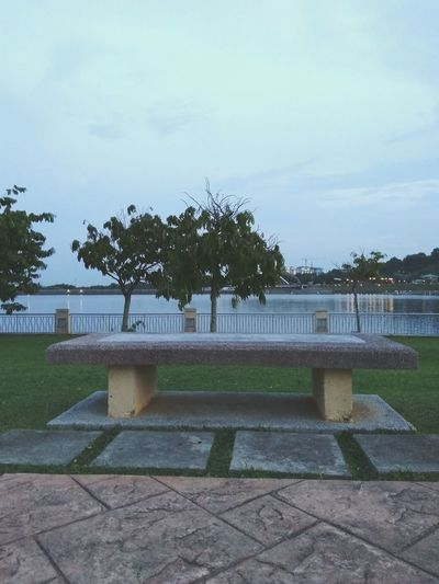 Bench Water Tree Architecture Sky No People Outdoors Day Waterfront Lake Built Structure Travel Destinations Architecture Facilities Rock Grass Park - Man Made Space Garden Viewpoint Lakeside Lakeside Park Lakeside Recreation