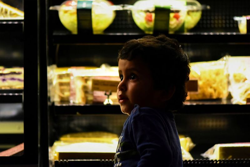 Portrait of boy looking at store