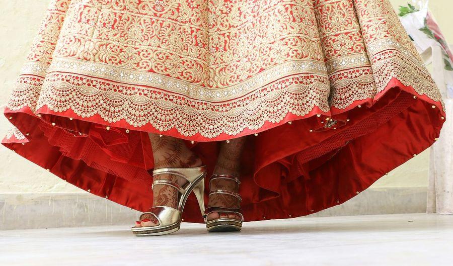 Low section of bride standing on floor