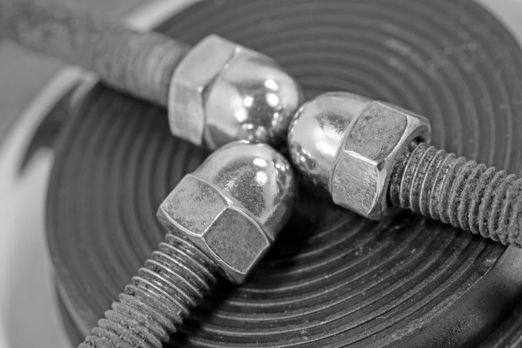 Screw Hutmutter Close-up Indoors  No People Metal Connection Cable Still Life Focus On Foreground Technology Work Tool Industry Spiral Selective Focus Detail Wealth Pattern Machinery Old Equipment