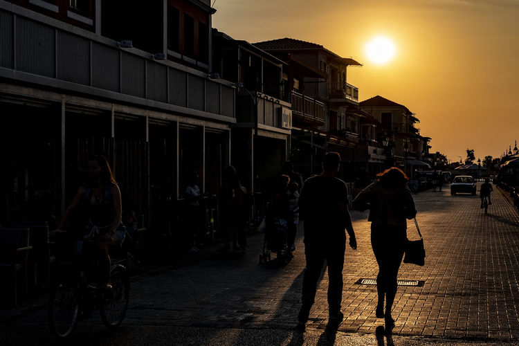 Backlight Capture Tomorrow Architecture Sunset Building Exterior Built Structure Sky Street City Lifestyles Real People Group Of People Full Length Men People Transportation Women Walking Sunlight Adult Leisure Activity Nature Sun