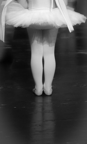 Low Section Of Girl Standing On Floor