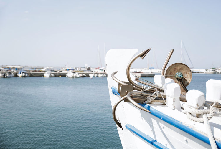 Boat with anchor at the harbor Holiday Anchor Boat Clear Sky Copy Space Day Fishing Boat Focus On Foreground Harbor Marina Nature Nautical Vessel No People Port Rope Sailboat Sailing Sea Sky Sunlight Transportation Travel Water Waterfront Yacht