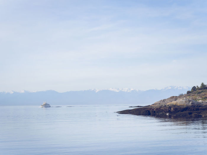 A peaceful view taken from McNeill Bay, Victoria BC, Canada, with the Olympic Mountains in the background Beauty In Nature Boat Boat, Victoria Canada Day Mountain Nature Nautical Vessel No People Outdoors Scenics Sea Sky Tranquil Scene Tranquility Vancouver Island Victoria Water Waterfront