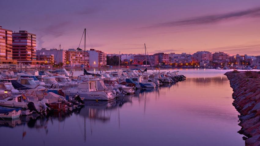 SONY A7ii Nachtaufname Himmel Langzeitbelichtung Nachtfotografie Spanien Architecture Building Exterior Built Structure City Cityscape Cloud - Sky Dusk Harbor Illuminated Mittelmeer Mittelmeerfeeling Moored Nautical Vessel Night No People Outdoors Purple Reflection Sea Sky Skyscraper Sunset Urban Skyline Water Waterfront Yacht