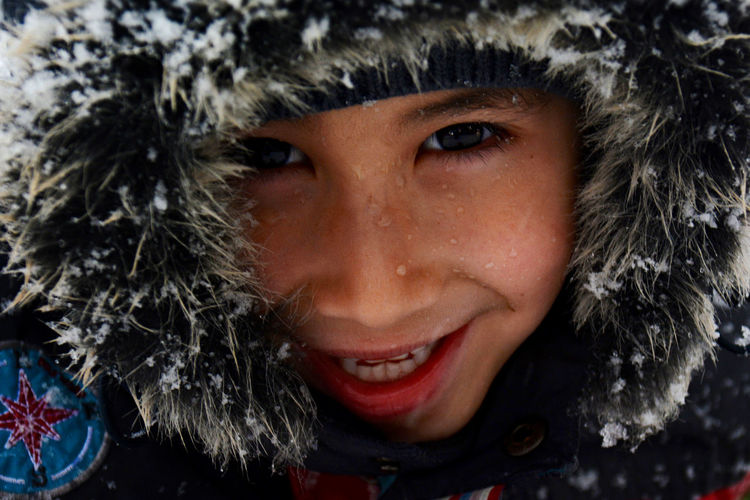 Close-up portrait of boy during winter