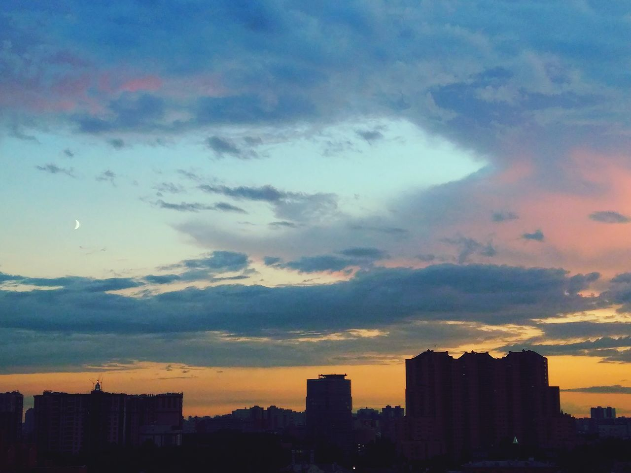 building exterior, architecture, sunset, skyscraper, modern, built structure, city, cityscape, sky, cloud - sky, no people, silhouette, outdoors, urban skyline, day