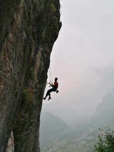 Man on rock against mountain range