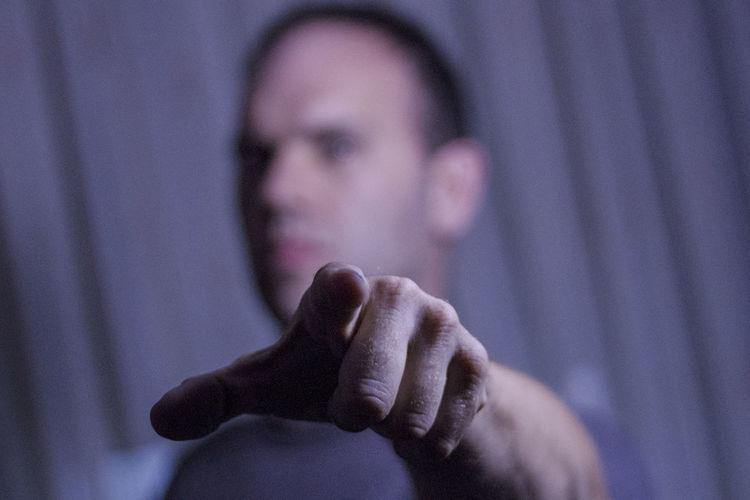 Close-up of man gesturing