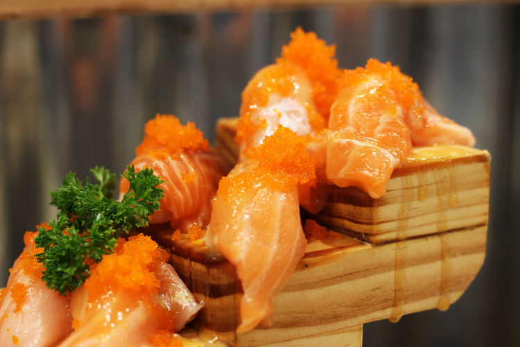 Salmon sushi on a ladder style. Close-up Day Food Food And Drink Freshness Healthy Eating Indoors  Japanese  Japanese Food No People Ready-to-eat Salmon Salmon Sushi Seafood