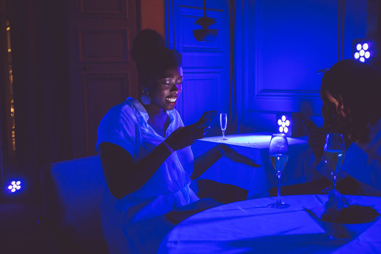 Man and woman sitting at illuminated table