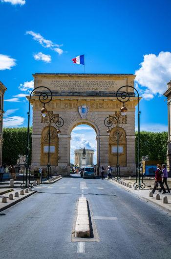 Porte du peyrou in city against sky