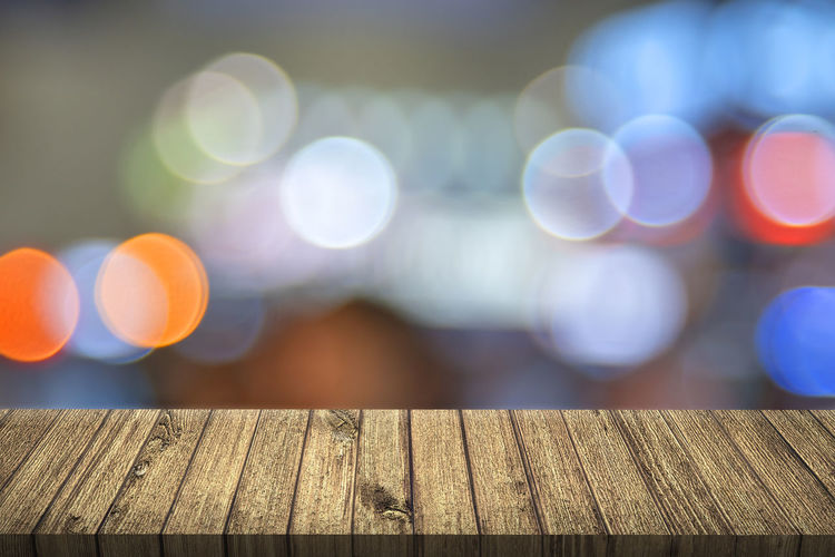 Wooden Table Against Colorful Lens Flare