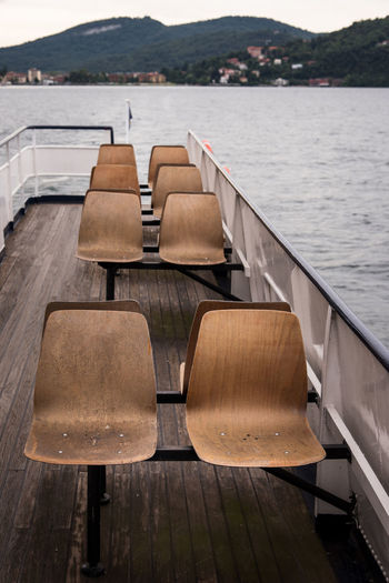 Vintage Seat Wooden Water Seat Lake Wood - Material No People Chair Absence Nature Empty Day Tranquility Mountain Scenics - Nature Beauty In Nature Tranquil Scene Nautical Vessel Pier Outdoors Table Mode Of Transport Departure Leaving