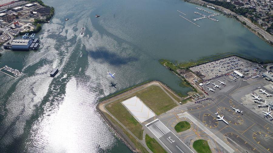 Aerial view of runway by sea