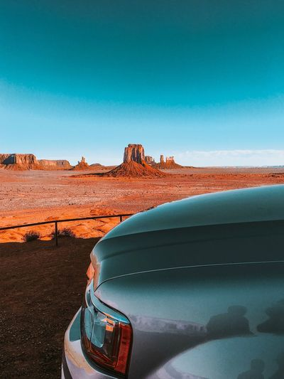 Car parked against monument valley