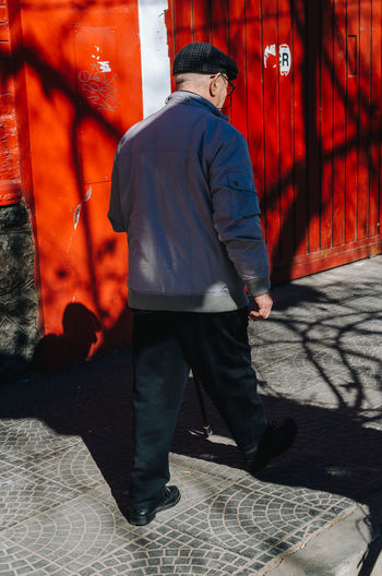 Mendozinos Real People One Person Full Length Rear View Men Shadow Clothing Red Day Footpath Lifestyles Leisure Activity Sunlight Architecture Casual Clothing Outdoors Walking Males  Sidewalk Streetphotography EyeEm Selects