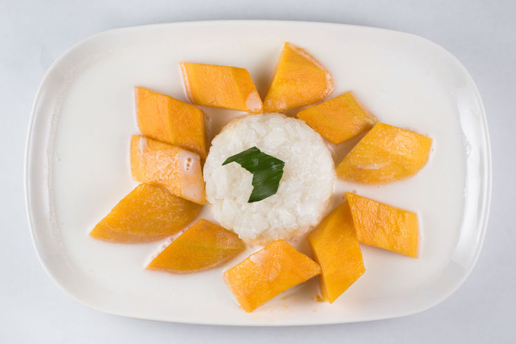 mango sticky rice or Khaoniao mamuang, a traditional thai cuisine ASIA Coconut Milk Glutinous Rice Mango Thailand Appetizer Close-up Culture Food Food And Drink Fresh Mango Freshness Gastronomy Healthy Eating Isolated White Background Khaoniao Mamuang Mango Fruit Mango Sticky Rice Plate Ready-to-eat Sticky Rice Studio Shot Sweet Temptation Thai Famous Food