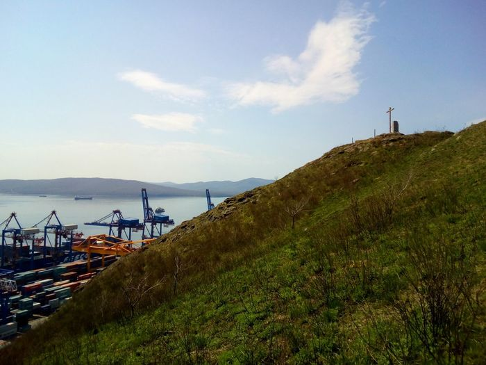 View from the hill Sea Port Trade Port Crane Landscape Cloud - Sky Sky Beauty In Nature Nature Outdoors Tranquility Day Water Horizon Over Water Scenics Hill Mountain Cross Grass No People Travel Destinations Spring
