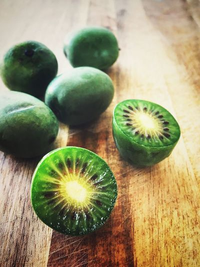 Kiwi berries Healthy Food Vitamin Berries Healthy Eating Food And Drink Food Healthy Eating Table Green Color Indoors  Wellbeing Fruit Freshness Still Life No People Kiwi SLICE Wood - Material Close-up Group Of Objects Green