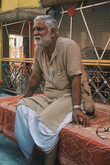 Casual Clothing Day Everyday Emotion Holy Place India Leisure Activity Outdoors Personal Perspective Portrait Priest Relaxing Sitting Temple Temples Thinking Indian Culture  Indian Temple Indian People People Person Man 43 Golden Moments Natural Light Portrait My Favorite Photo The Portraitist - 2017 EyeEm Awards The Portraitist - 2018 EyeEm Awards