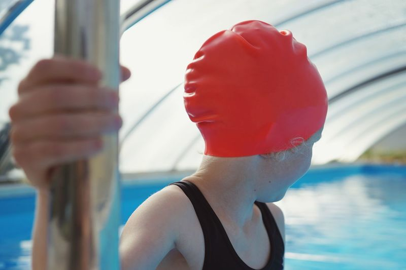Close-Up Of Girl Wearing Red Swimming Cap