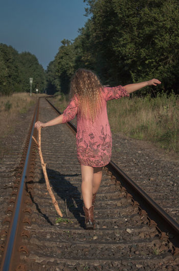 Balance Beautiful Woman Blond Hair Day Enjoying Life Enjoying The Sun Full Length Go For A Walk Lifestyles Nature One Person Outdoors Rail Transportation Railroad Track Real People Rear View Sky Sunshine Transportation Tree Walking Around Young Adult Young Women Cowboy Boots Long Hair Done That.