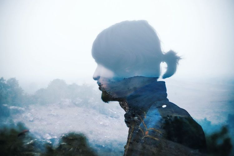 Double exposure of man and mountain